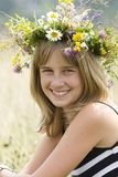 Girl with flower wreath Stock Photo