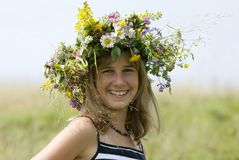 Girl with flower wreath Stock Image