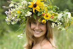 Girl with flower wreath. In the meadow Royalty Free Stock Photography