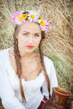 Girl with flower wreath Stock Photos