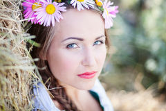 Girl with flower wreath Stock Images