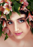 Girl with flower wreath. Caucasian woman with gray eyes and brow Royalty Free Stock Photos