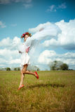 Girl in flower wreath with white shawl dancing on Royalty Free Stock Photo