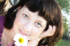 Girl with flower Stock Images