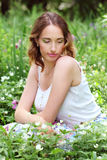 Girl in flowerbed Stock Image