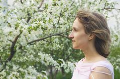 Girl with a flowering tree Stock Photo