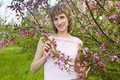 Girl among flowering trees Stock Images