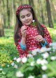 Girl in flowers Stock Photos