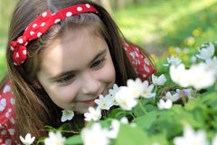 Girl in flowers Stock Images
