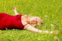 GIRL BETWEEN FLOWERS Royalty Free Stock Image