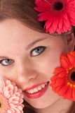 The girl and flowers. The beautiful girl with red and pink flowers Stock Photo