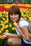 Girl and flowers. Royalty Free Stock Photo