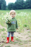 Girl with flowers. Little girl holding a bouquet of wild flowers Royalty Free Stock Photo