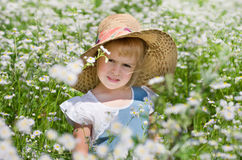 A girl among the flowers Stock Photography