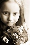 Girl with Flowers Stock Photography