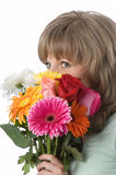 The girl and flowers. The girl looks atop of a beautiful bouquet of flowers Stock Photo