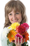 The girl and flowers. The girl looks atop of a beautiful bouquet of flowers Stock Images