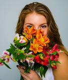 Girl with flowers Stock Image