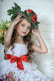 Girl with flowers. Vintage Girl with Flowers in her hair Stock Images