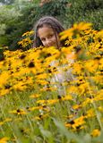 Girl and flowers. Happy girl and yellow flowers Royalty Free Stock Photography