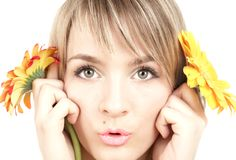 The girl with flowers Stock Photography