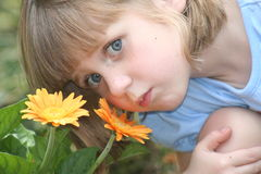 Girl with flowers. Girl smelling flowers Royalty Free Stock Photography