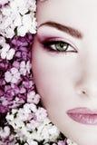 Girl in flowers Stock Image