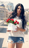 Girl with flowers beauti top Royalty Free Stock Images