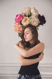 Girl and flowers Stock Images