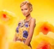 Girl among flowers Royalty Free Stock Photo