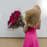 Girl with the flowers. Girl with a bouquet of the flowers Royalty Free Stock Photography