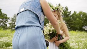 Girl Flowers Bunch Photograph Floral Wreath Pose. Pretty Caucasian Blonde Child Blossom Meadow Summer Field. Cute Female Kid Enjoy Nature Hold Wildflowers stock footage