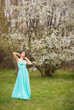 Girl in flowers of cherry Royalty Free Stock Image