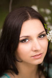 Girl in flowers of cherry Royalty Free Stock Photography