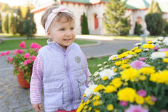 Girl and Flowers Stock Photography