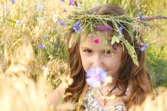 Girl with flowers diadem on her head Stock Photos