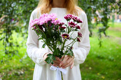 Girl with flowers. Do a present Royalty Free Stock Photos