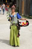 Girl with flowers dressed in medieval costume Stock Photo