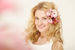 Girl with flowers in hair Royalty Free Stock Photos