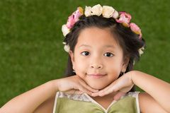 Girl with flowers in hair Stock Images