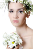 Girl with flowers in hair on white Stock Images