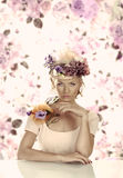 Girl with flowers on the hat in front of the camera stock photos