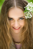 Girl with flowers in her hair close up Stock Photography