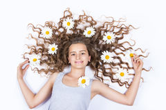 Girl with flowers in her hair Stock Photography