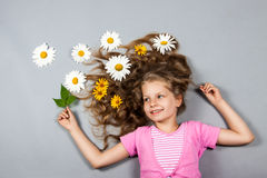 Girl with flowers in her hair Royalty Free Stock Images