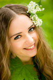 Girl with flowers in her hair macro Royalty Free Stock Images