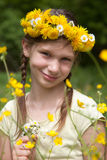 Girl with flowers on her head in nature Stock Photo