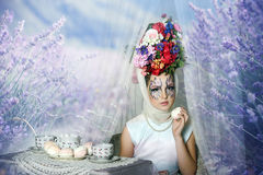 Girl with flowers on her head stock image