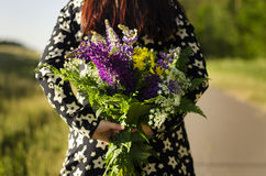 Girl with flowers Stock Images