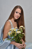 Girl with flowers IV Royalty Free Stock Photography